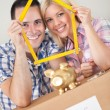 Young couple buying new home — Stock Photo #32745221