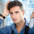 Man applying hair spray — Stock Photo