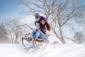 Couple sledging through — Stock Photo