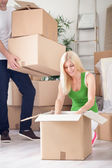Unpacking in new apartment — Stock Photo