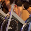 Indoor bicycle cycling in gym — Stock Photo
