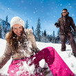 Couple playing in snow — Stock Photo