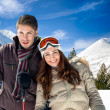 Couple in warm clothes on mountains — Stock Photo