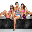 Sexy girls sitting on large speaker — Stock Photo