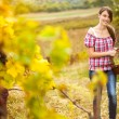 Young peasant woman in the vineyard — Stock Photo