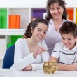 Family saving money — Foto Stock