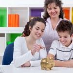 Family saving money — Stock fotografie