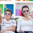 Watching TV with 3D glasses — Stockfoto