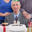 Senior man celebrating birthday with family — Stock Photo