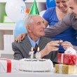 Senior man on birthday with his family — Stock Photo