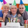 Happy family celebrating birthday together — Foto Stock