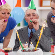 Senior man celebrating birthday — Stock Photo #35598381