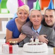Portrait of happy family on 70th birthday — Stock Photo