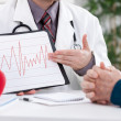 Cardiologist showing EKG results — Foto Stock