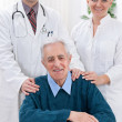 Medical team with patient — Stock Photo