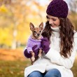 Cute woman with her Miniature Pinscher — Stock Photo