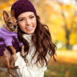 Woman holding her puppy after in the park — Stock Photo