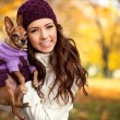 Woman holding her puppy after in the park — Stock Photo #35598877