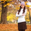 Portrait of girl in autumn park — Stock Photo