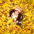 Adorable woman in the autumn park — Stock Photo