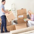 Couple unpack moving boxes. — Stock Photo