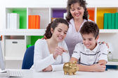 Family saving money — Stock Photo