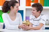 Children saving money — Stockfoto