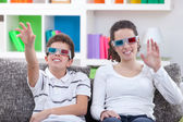 Watching TV with 3D glasses — Stock Photo