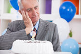 Sad senior man forgot how old is — Stock Photo