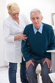 Nurse helps senior man — Stock Photo