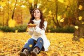 Happy woman enjoying in autumn — Stock Photo