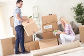 Couple unpack moving boxes. — Stock Photo