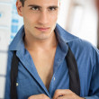 Men buttoning his shirt — Stock Photo #35600933