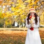 Beautiful modern woman in autumn park — Stock Photo