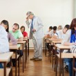 Senior teacher with class — Stock Photo