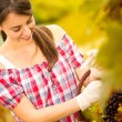 Stock Photo: Cheerful woman harvesting grapes