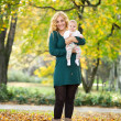 Mother and daughter baby in park — Stock Photo