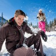 Winter couple snowball fight — Stock Photo