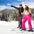 Couple with snow skis — Stock Photo