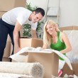 Cheerful couple in new home — Stock Photo