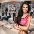 Portrait of sporty woman in gym — Stock Photo