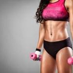 Fit woman lifting dumbbells — Stock Photo
