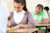 Cheerful student during test — Stock Photo