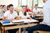 Students listening a lecturer — Stock Photo