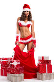 Santa girl with lot of presets and big red bag — Stock Photo