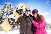 Adorable couple enjoying in wintertime — Stock Photo