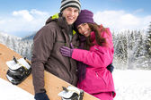 Affectionate couple on winter holiday — Stock Photo