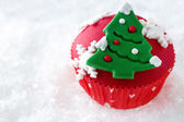 Red decorative Christmas cupcake — Stock Photo