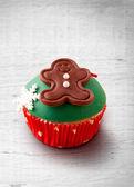 Christmas cupcake on a wood table — Stock Photo