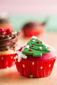 Christmas cupcake with decorative symbols — Stock Photo